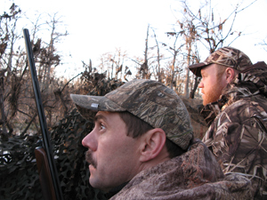 Vanishing Paradise team members Andy McDaniels and Land Tawney wait for waterfowl in the Louisiana wetlands.