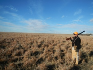 A wind farm backdrops this Colorado pheasant hunter. Photo by Lew Carpenter.