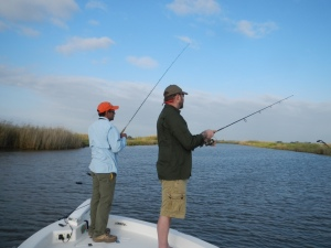 Cajun Fishing Adventure's guide Joe Dimarco (left) and VPSAC member from Arkansas, Gabe Galster working a canal near Quarantine Bay for redfish. Photo by Lew Carpenter
