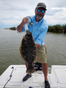 Lew Carpenter with 6.5-pound flounder. Access and habitat rely on re authorization of Magnuson-Stevens Fishery Conservation and Management Act.